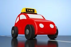 Αυτοκίνητο παιχνιδιών κινούμενων σχεδίων με το σημάδι ταξί Στοκ φωτογραφία με δικαίωμα ελεύθερης χρήσης