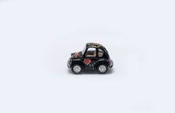 Αυτοκίνητο παιχνιδιών σε ένα άσπρο υπόβαθρο Στοκ Εικόνες