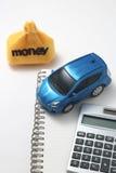 Αυτοκίνητο, χρήματα, υπολογιστής, και σημειωματάριο παιχνιδιών Στοκ Εικόνες
