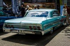 Αυτοκίνητο Chevrolet Impala SS, 1964 φυσικού μεγέθους απομονωμένο οπισθοσκόπο λευκό Στοκ φωτογραφία με δικαίωμα ελεύθερης χρήσης