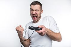 Αυτό το άτομο έχει κερδίσει το παιχνίδι και είναι ευχαριστημένος από αυτό Θέλει να παίξει λίγο περισσότερο η ανασκόπηση απομόνωσε στοκ εικόνες