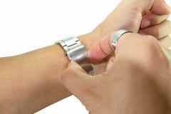 Αφαιρέστε το ρολόι από τον καρπό Στοκ Φωτογραφία