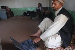 αφγανική εργασία ατόμων lap-top Στοκ Εικόνες