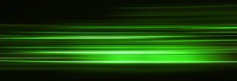 Αφηρημένα ίχνη πράσινου φωτός στο σκοτάδι, επίδραση θαμπάδων κινήσεων στοκ φωτογραφία με δικαίωμα ελεύθερης χρήσης