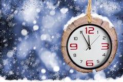 Αφηρημένα υπόβαθρα Χριστουγέννων με τα παλαιά ρολόγια Στοκ Εικόνες