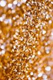 Αφηρημένα φω'τα διακοπών πουλιών χρυσά στο υπόβαθρο Στοκ Εικόνες