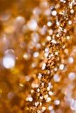 Αφηρημένα φω'τα διακοπών πουλιών χρυσά στο υπόβαθρο Στοκ Φωτογραφία