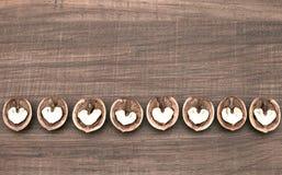 Αφηρημένες καρδιές στα ξύλα καρυδιάς Στοκ εικόνα με δικαίωμα ελεύθερης χρήσης