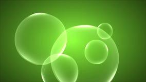 Αφηρημένες φυσαλίδες σαπουνιών σε ένα πράσινο υπόβαθρο