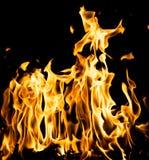 αφηρημένη ανασκόπηση Φλόγες πυρκαγιάς σε μια μαύρη ανασκόπηση Στοκ Εικόνες