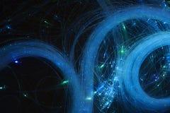 αφηρημένη ανασκόπηση φωτεινό να στροβιλιστεί Κομψή πυράκτωση Να προκαλέσει το μόριο Glint γραμμές Στοκ Φωτογραφίες
