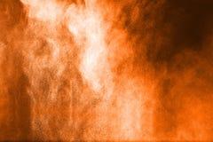 Αφηρημένη πορτοκαλιά έκρηξη σκονών στο μαύρο υπόβαθρο Στοκ φωτογραφίες με δικαίωμα ελεύθερης χρήσης