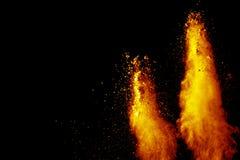 Αφηρημένη πορτοκαλιά έκρηξη σκόνης στο μαύρο υπόβαθρο Στοκ Φωτογραφίες