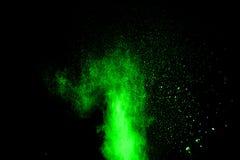 Αφηρημένη πράσινη έκρηξη σκόνης στο μαύρο υπόβαθρο Στοκ Εικόνες