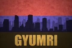 Αφηρημένη σκιαγραφία της πόλης με το κείμενο Gyumri στην εκλεκτής ποιότητας αρμενική σημαία στοκ εικόνες με δικαίωμα ελεύθερης χρήσης