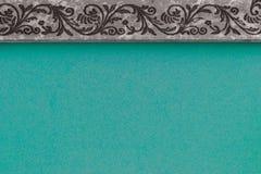 Αφηρημένη σύνθεση με τη βαθυγάλανη επιφάνεια υποβάθρου και γκρίζο πλαίσιο με το σχέδιο Στοκ εικόνες με δικαίωμα ελεύθερης χρήσης