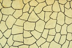 Αφηρημένη σύσταση με ένα σχέδιο μωσαϊκών του μονότονου κίτρινου χρώματος στοκ φωτογραφία