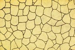 Αφηρημένη σύσταση με ένα σχέδιο μωσαϊκών του μονότονου κίτρινου χρώματος στοκ φωτογραφία με δικαίωμα ελεύθερης χρήσης