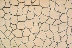 Αφηρημένη σύσταση με ένα σχέδιο μωσαϊκών του μονότονου χρώματος κρέμας στοκ φωτογραφία