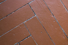 Αφηρημένη ταπετσαρία, χρωματισμένο πάτωμα παρκέ, παρκέ ψαροκόκκαλων, καφετί υπόβαθρο Στοκ φωτογραφία με δικαίωμα ελεύθερης χρήσης