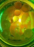 Αφηρημένη φωτογραφία που χρησιμοποιεί το μίγμα ελαίου και νερού Κλείστε επάνω την αφηρημένη φωτογραφία Στοκ Φωτογραφία