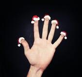 Αφηρημένοι άνθρωποι Χριστουγέννων Δάχτυλα Χριστουγέννων στο καπέλο Santa Στοκ φωτογραφία με δικαίωμα ελεύθερης χρήσης