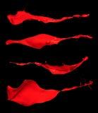 Αφηρημένοι κόκκινοι παφλασμοί στο μαύρο υπόβαθρο Στοκ φωτογραφία με δικαίωμα ελεύθερης χρήσης