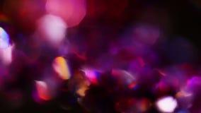 Αφηρημένοι κύκλοι χρώματος bokeh στους ιώδεις τόνους φιλμ μικρού μήκους