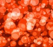 Αφηρημένος ζωηρόχρωμος, πορτοκάλι bokeh ακτινοβολεί υπόβαθρο για την ευτυχία απεικόνιση αποθεμάτων