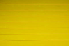 Αφηρημένος κίτρινος ξύλινος τοίχος σύστασης υποβάθρου Στοκ Φωτογραφία
