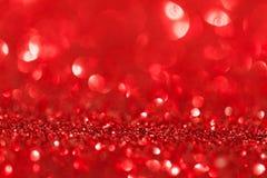 Αφηρημένος κόκκινος άστραψε υπόβαθρο Χριστουγέννων Στοκ εικόνα με δικαίωμα ελεύθερης χρήσης