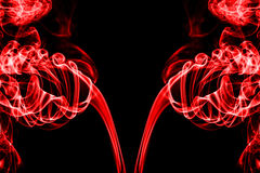 Αφηρημένος κόκκινος καπνός στο μαύρο υπόβαθρο Στοκ Εικόνες