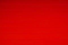 Αφηρημένος κόκκινος ξύλινος τοίχος σύστασης υποβάθρου Στοκ Εικόνα