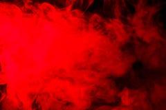 Αφηρημένος κόκκινος-πορτοκαλής καπνός hookah σε ένα μαύρο υπόβαθρο Στοκ Φωτογραφίες