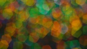 Αφηρημένος πολύχρωμος ακτινοβολεί τα φω'τα και τα σπινθηρίσματα απόθεμα βίντεο
