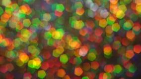 Αφηρημένος πολύχρωμος ακτινοβολεί τα φω'τα και τα σπινθηρίσματα φιλμ μικρού μήκους