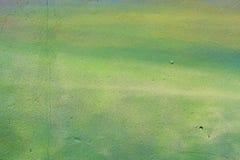 Αφηρημένος πράσινος τοίχος με τις ρωγμές Στοκ Φωτογραφίες