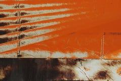 Αφηρημένος συνδυασμός και σκουριά χρώματος που βλέπουν σε ένα κομμάτι των βαριών μηχανημάτων Στοκ Φωτογραφίες