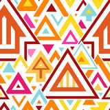 Αφηρημένο γεωμετρικό άνευ ραφής σχέδιο με τα ζωηρόχρωμες τρίγωνα και τις γραμμές στοκ εικόνες με δικαίωμα ελεύθερης χρήσης