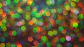 Αφηρημένο καμμένος υπόβαθρο φω'των Μακροεντολή Το ολόγραμμα φωτεινότητας ακτινοβολεί σπινθηρίσματα απόθεμα βίντεο