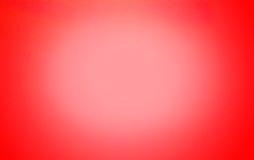 Αφηρημένο κόκκινο υπόβαθρο με το επίκεντρο Στοκ Εικόνες