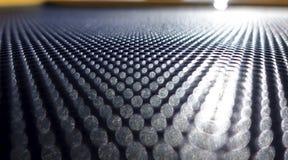 Αφηρημένο μεταλλικό υπόβαθρο με τις στρογγυλές τρύπες στοκ εικόνα