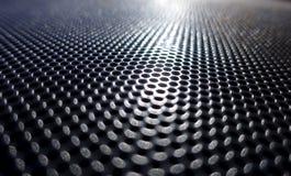 Αφηρημένο μεταλλικό υπόβαθρο με τις στρογγυλές τρύπες στοκ φωτογραφίες