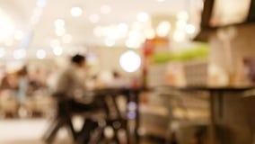 Αφηρημένο μουτζουρωμένο δικαστήριο τροφίμων στην υπεραγορά/τη λεωφόρο απόθεμα βίντεο