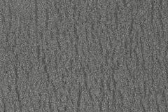 Αφηρημένο τραχύ γκρίζο υπόβαθρο επιφάνειας Παρόμοιος με την άσφαλτο, σκυρόδεμα, πλαστικό Γκρίζα σύσταση μεταλλινών των κυττάρων στοκ φωτογραφίες