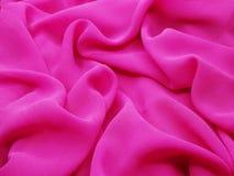 Αφηρημένο υποβάθρου ανοιχτό ροζ κυμάτων μεταξιού υλικό Στοκ Εικόνες
