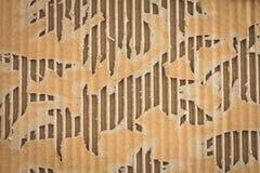 Αφηρημένο υπόβαθρο από το σχισμένο καφετί χαρτόνι Στοκ φωτογραφία με δικαίωμα ελεύθερης χρήσης