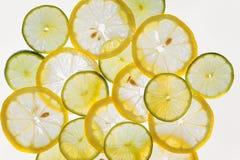 Αφηρημένο υπόβαθρο, λεμόνια και ασβέστης σχεδίων φετών εσπεριδοειδούς Στοκ Εικόνα