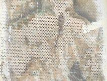 Αφηρημένο υπόβαθρο με τις τρύπες στον τοίχο Στοκ Εικόνες
