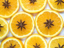 Αφηρημένο υπόβαθρο με το εσπεριδοειδές των πορτοκαλιών φετών και του γλυκάνισου αστεριών Στοκ εικόνες με δικαίωμα ελεύθερης χρήσης